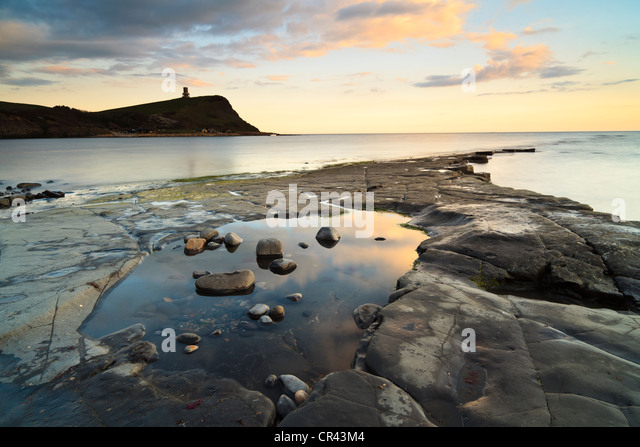 Sunset at Kimmeridge Bay, Dorset, UK, with Clavell's Tower in the background - Stock Image