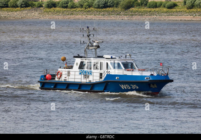 Hamburg, Germany - June 26, 2016, Boat WS35 of the german Wasserchutzpolizei = Water Police Hamburg on the Elbe - Stock Image