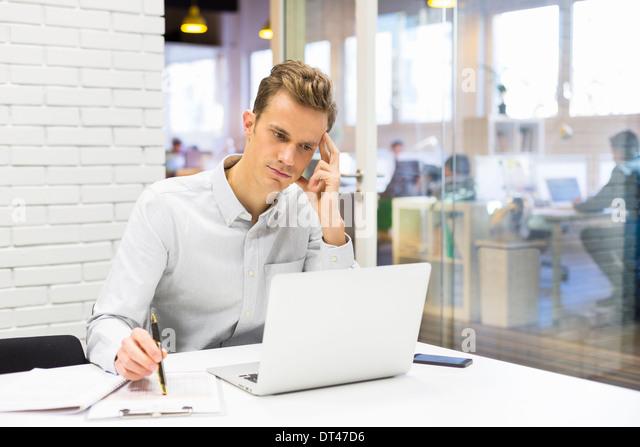 Male business computer desk start-up - Stock Image