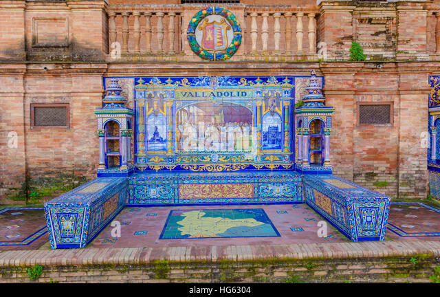 Glazed tiles bench of spanish province of Valladolid at Plaza de Espana, Seville, Spain - Stock Image