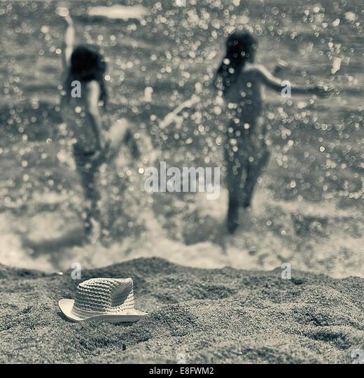 View of girls having fun in sea - Stock Image