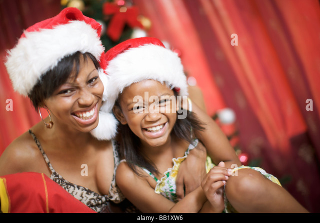 Mother and daughter laughing at Christmas, Pietermaritzburg, KwaZulu-Natal Province, South Africa - Stock Image