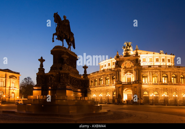 Dresden theatre square semper opera house equestrian statue of King John twilight - Stock Image