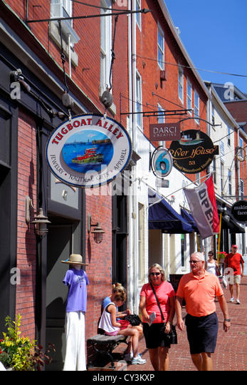 New Hampshire Portsmouth Bow Street businesses signs shopping man woman couple walking - Stock Image