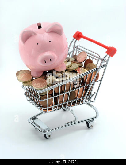 PIGGYBANK ON SUPERMARKET SHOPPING TROLLEY RE PENSIONS INCOMES FOOD PRICES SAVINGS INVESTMENTS ANNUITY PENSION POT - Stock Image