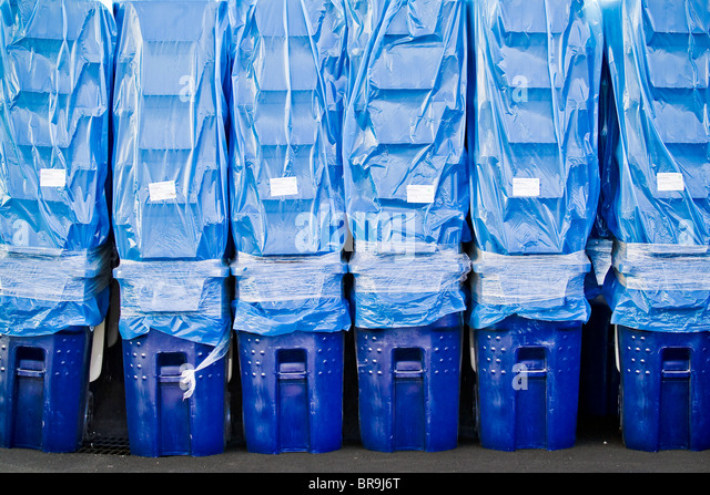 Stacks of blue recycling bins stand ready for distribution to the town of Bend Oregon. - Stock Image