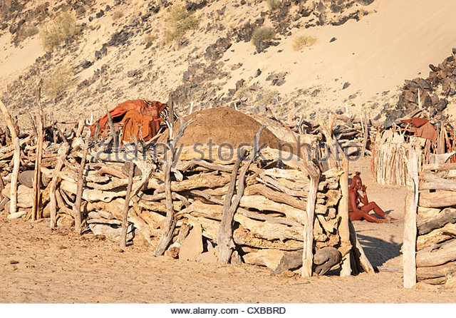 Wooden fence surrounding a typical Himba village, Purros, Namibia, Africa - Stock Image
