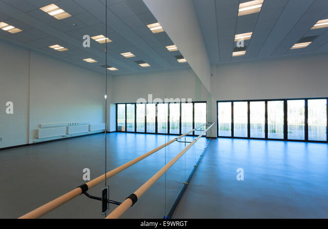unoccupied dance studio with mirrors and ballet barre stock image