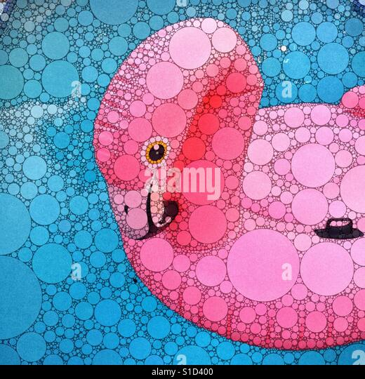 A digital artwork of a large inflatable pink flamingo floating in a swimming pool. - Stock-Bilder