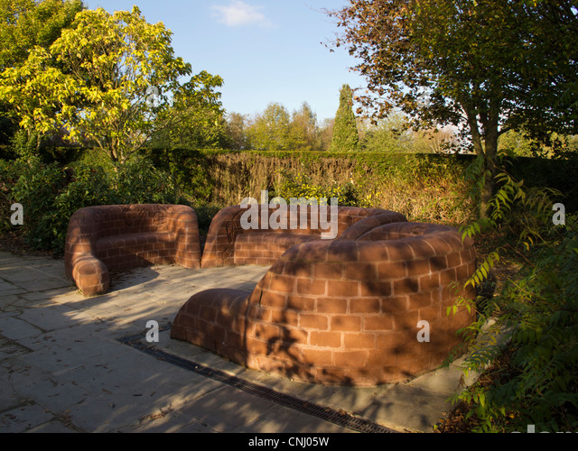 Centenary  Seat made from red brick clay  in the grounds of Rufford Abbey Nottinghamshire - Stock Image