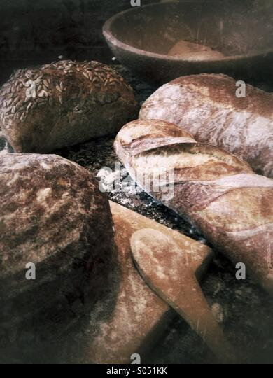 Artisan breads and cutting board. - Stock Image