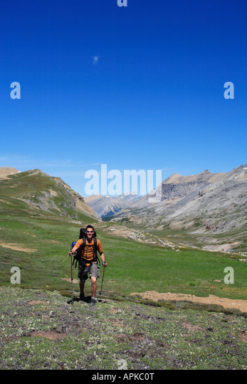 Man backpacking or trekking in Banff National Park - Stock Image