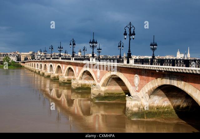 The Pont de Pierre bridge crossing the river Garonne, Bordeaux, France in the city centre - Stock Image