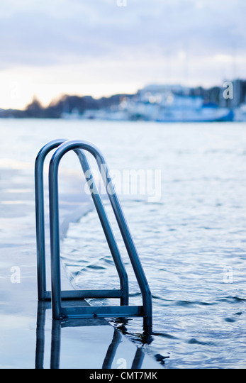 Ladder handles on a dock - Stock Image