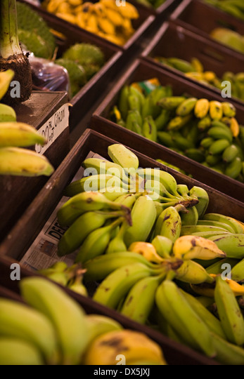Banana bunches on display at market, high angle view - Stock Image