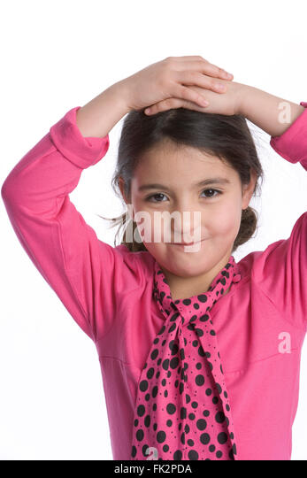 Little Girl Is Looking Into The Camera With A Timid Expression on white background - Stock Image