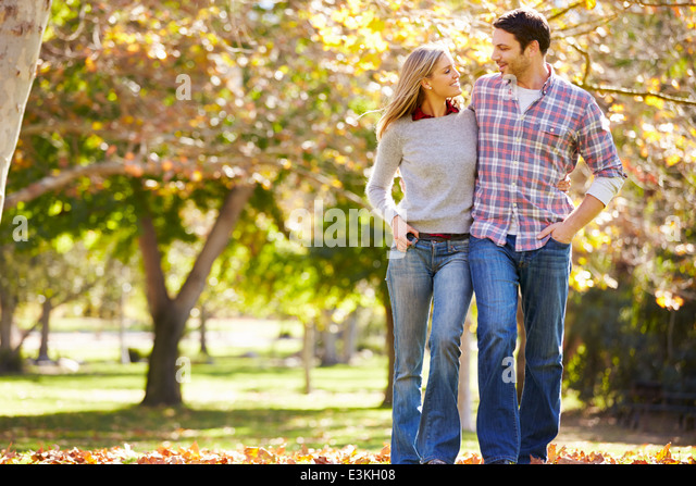 Romantic Couple Walking Through Autumn Woodland - Stock-Bilder