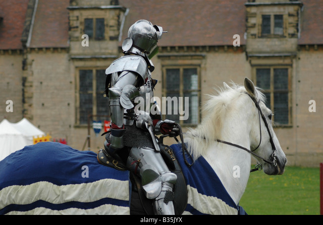 Knight on white charger - Stock Image