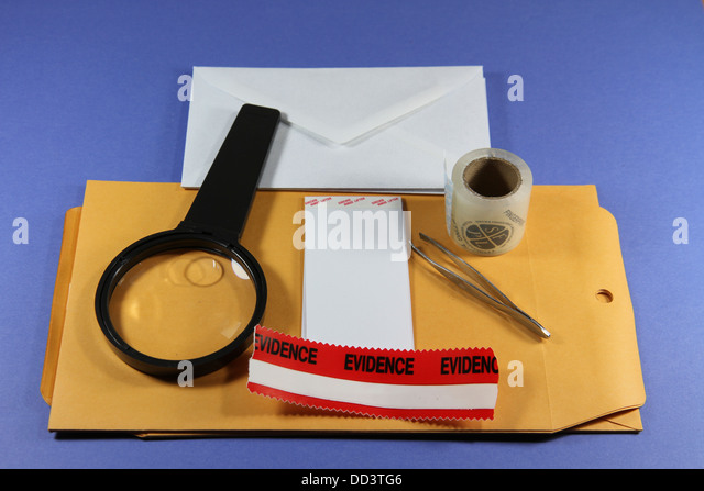 Forensic evidence gathering kit with magnifying glass, evidence tape, hinge lifters, fingerprint tape, envelopes. - Stock Image