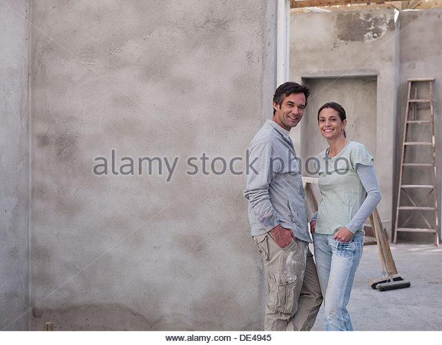 Couple in house under construction - Stock-Bilder