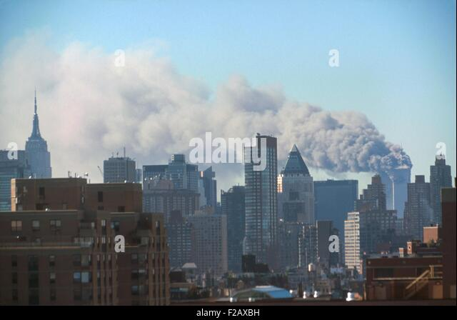 Smoke billowing from the Twin Towers following September 11th terrorist attack on World Trade Center. Photo taken - Stock-Bilder