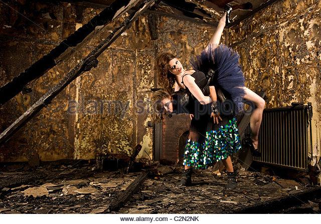 Caucasian Fashion Models in Burnt Building - Stock-Bilder
