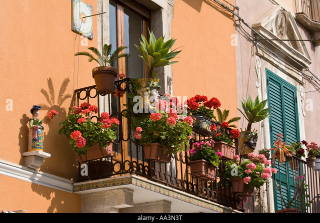 Sicily apartment stock photos sicily apartment stock for Best flowers for apartment balcony