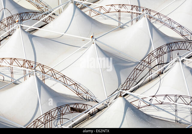 Aerial view from above looking down from above at  abstract patterns of roof panels on a temporary pavilion marquee - Stock Image