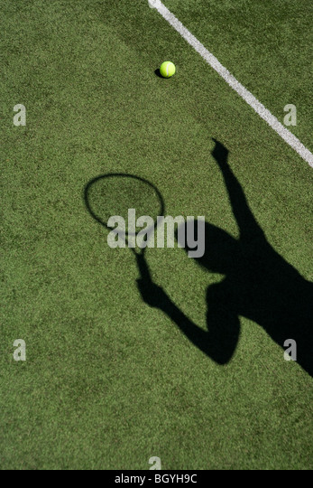 Shadow playing tennis - Stock Image