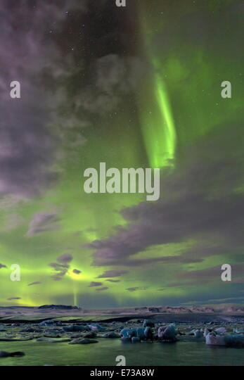 The Aurora Borealis (Northern Lights) over Jokulsarlon glacial lagoon on the edge of the Vatnajokull National Park, - Stock-Bilder