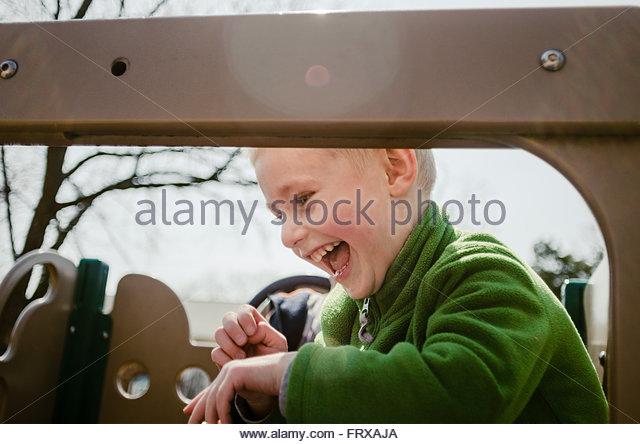 Happy kid at the playground - Stock Image