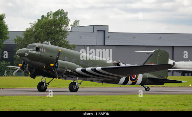 Douglas C-47A Skytrain, military version of the DC-3 Dakota,in USAAF D-Day markings at Biggin Hill Air Show, Bromley, - Stock Image