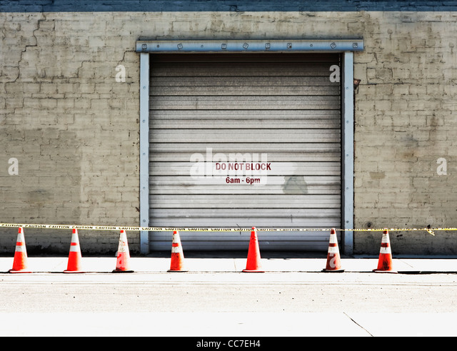 do not block sign painted on loading area door - Stock Image