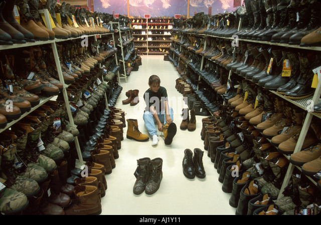 Ohio Nelsonville Rocky Shoes & Boots Factory Outlet shopper in showroom tries Gortex boots - Stock Image