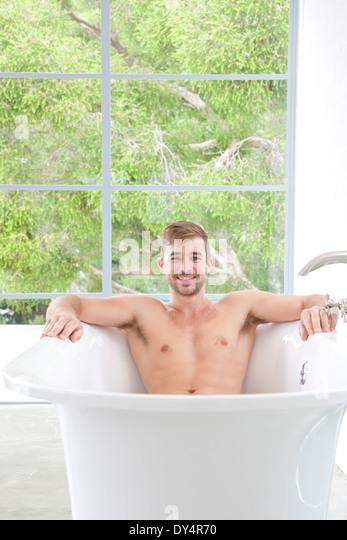 Smiling Man in Bathtub - Stock Image