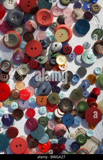 Scattered colourful buttons - Stock Image