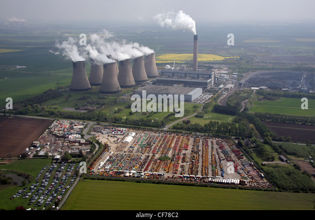 Aerial view of machinery auction site with Drax Power Station near Selby - Stock Image