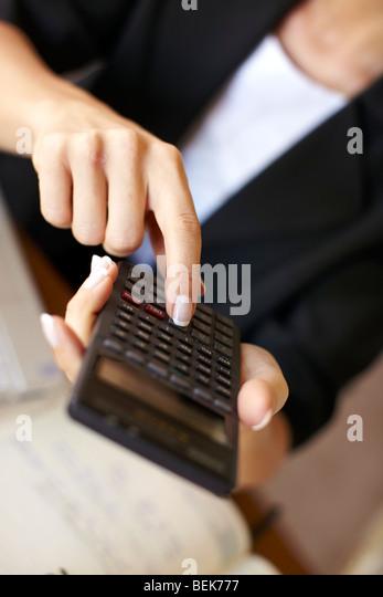 Woman working out finances - Stock-Bilder
