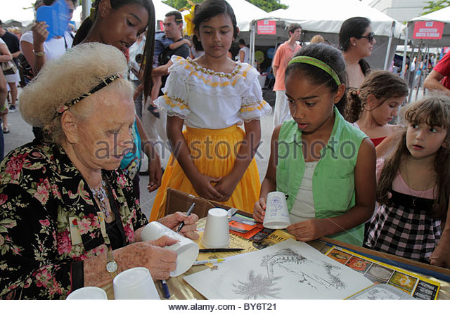 Miami Florida Adrienne Arsht Center for the Performing Arts Fall for the Arts Festival booth exhibitor Black girl - Stock Image