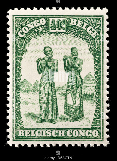 Postage stamp from the Belgian Congo depicting native men playing instruments. - Stock-Bilder