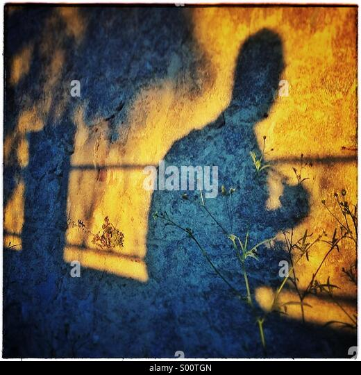 Shadow  of a man walking - Stock Image