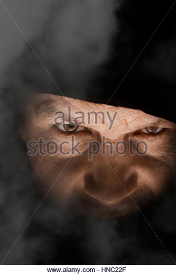 Angry man in fog - Stock-Bilder