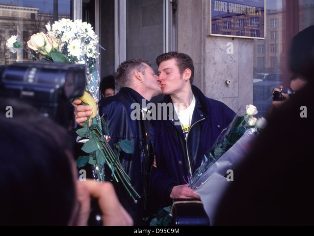 Yaroslav Mogutni, 20 (Right) and Robert Fillipini, 42, kiss after they attempt to register for marriage in Moscow, - Stock Image