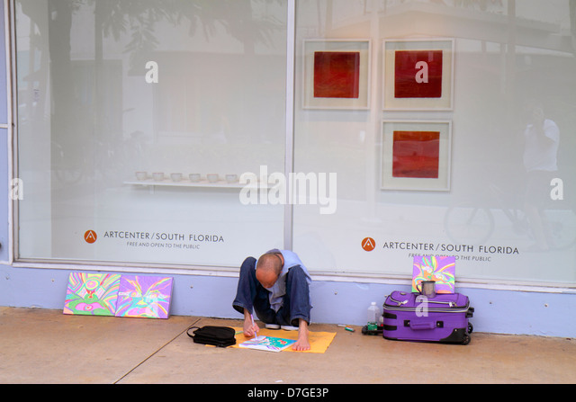 Miami Beach Florida Lincoln Road pedestrian mall armless no arms man disabled painting artist with foot feet for - Stock Image