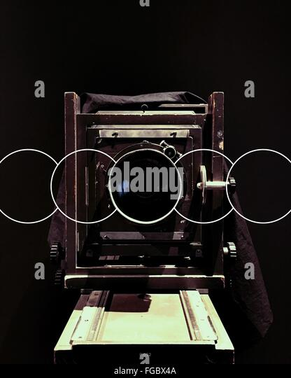 Close-Up Of Vintage Camera Over Black Background - Stock Image