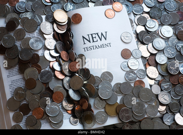New Testament; New Testament Bible And Money - Stock Image