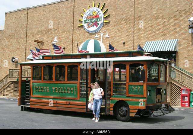 Toledo Ohio Erie Street Market TARTA Trolley public transportation women riders - Stock Image