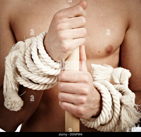 man with a cord on hands - Stock Image