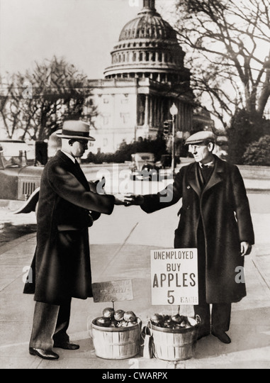 The Great Depression. Unemployed man sells apples near the Capitol in Washington D.C.  As the Great Depression deepened - Stock Image