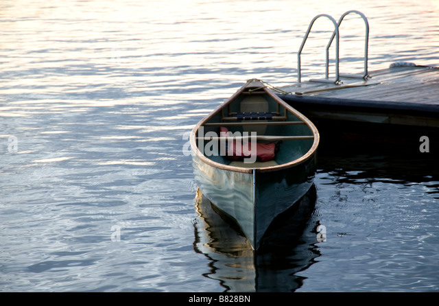 Canoe at a dock, Lake of the Woods, Ontario, Canada - Stock Image